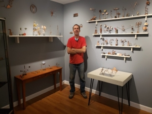 """Joel Bourgeois with his """"Copper Critters"""" installation"""